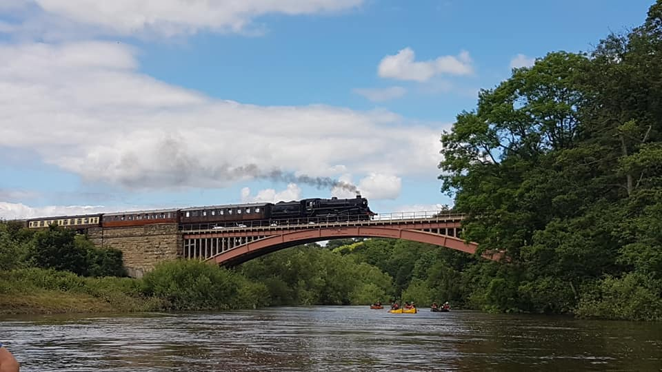 Severn Valley Railway steam train over Hire a Canoe yellow canoes on the River Severn Bridgnorth Arley Bewdley