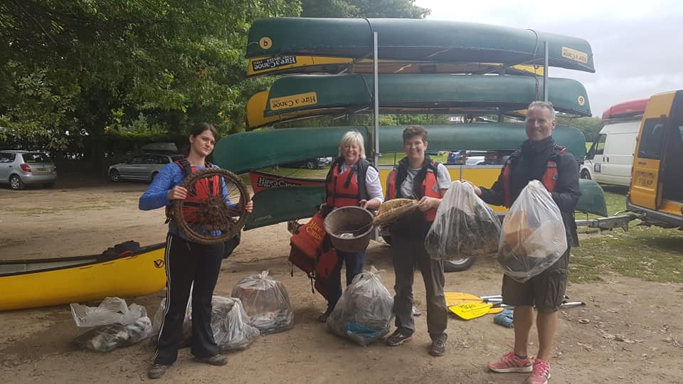 Hire a Canoe litter picking plastic paddlers